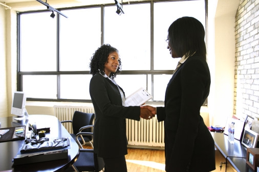 BUSInterviewDealHandshakeWomen1