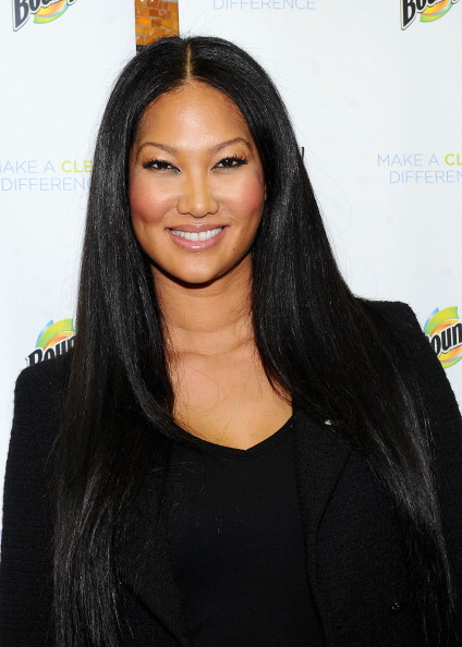 kimora lee simmons 2011 pictures. Wife, mom, mogul: Kimora Lee