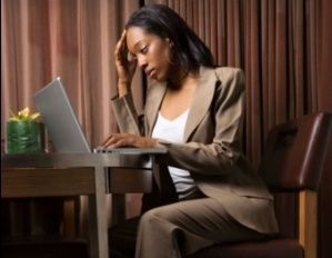 black woman stress working on her laptop