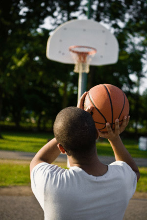 kid shooting a basketball