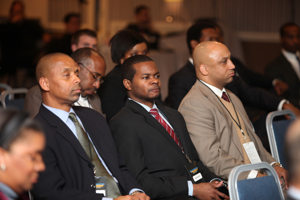 Attendees focus intently on panels addressing green jobs and business opportunities.