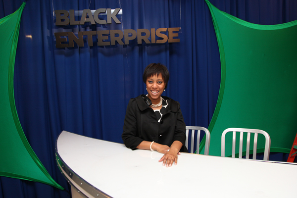 Black Enterprise Integrate Marketing Manager Diana Hilson greets forum attendees.