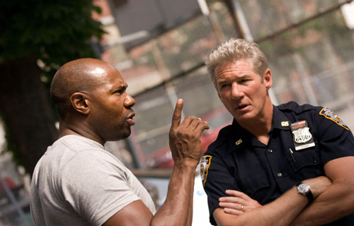 """Fuqua on box office double standards:  """"There are a lot of different challenges [for black filmmakers]. Some are the same challenges that every director has. But for us, if you have a failure or two, walking into the room [with studio executives] you already have one foot being pushed back out,"""" said Fuqua (shown above directing Richard Gere in a scene from Brooklyn's Finest). """"That is just something you're going to have to deal with.""""  (Image source: Overture Films)"""