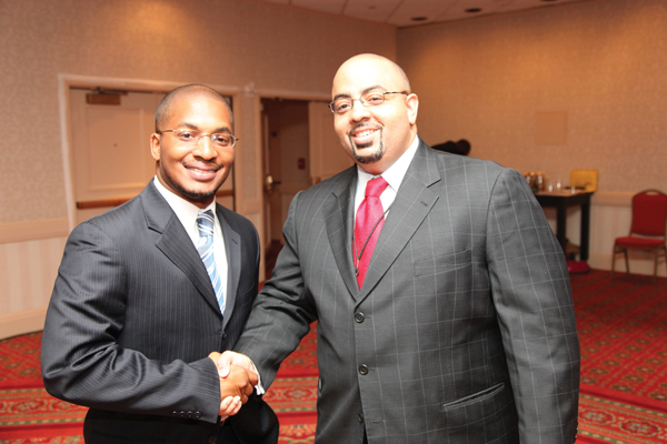 Marcus Evans, CEO of Never Forgotten, a Herndon, Va.-based full-service grave site care and maintenance company, is greeted by Black Enterprise Editorial Director Alan Hughes after winning the 2009 Black Enterprise Elevator Pitch competition.