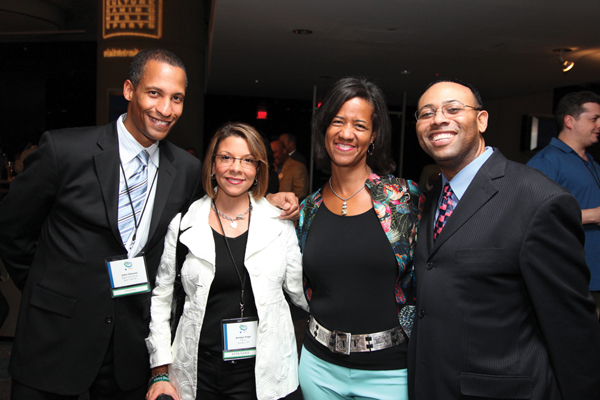 Black Enterprise Senior Personal Finance Editor John W. Simons (left) and Attorney and radio talk show host Warren Ballentine (right) with conference attendees.