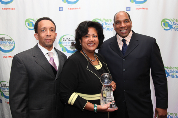 "Valerie Phillips, owner of The Phillips Co. Inc. of Columbus, Indiana, accepts the 2009 Black Enterprise Small Business of the Year Award, flanked by Ariel Investments Senior VP Jason Tyler and Black Enterprise CEO Earl ""Butch"" Graves Jr."