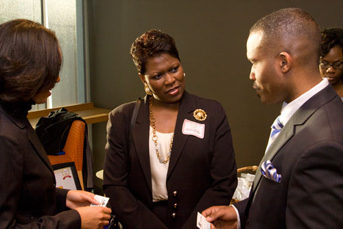 Atlanta Business League CEO Leona Barr-Davenport (center) with Di Yonna and Yohance Mitchell of Vision Tutoring.