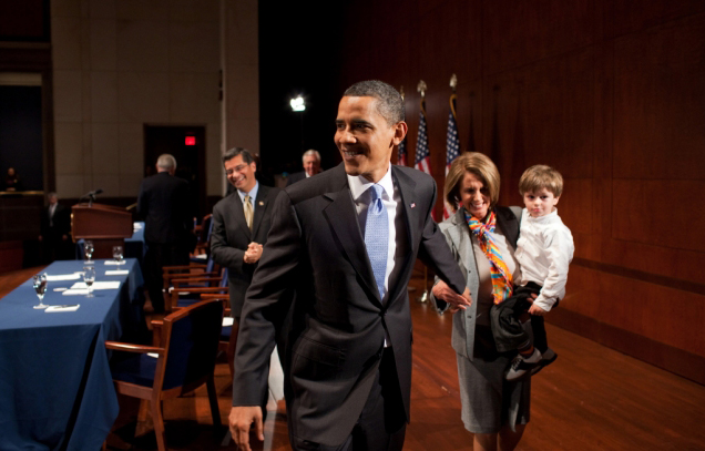 President Barack Obama greets House Speaker Nancy Pelosi and her grandson, following a meeting with Democratic Members of Congress to discuss the health insurance reform vote at the U.S. Capitol in Washington, D.C., March 20, 2010.  (Source: White House)