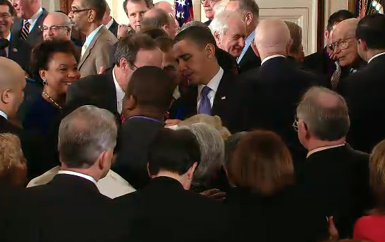 After signing the sweeping healthcare reform bill into law, President Obama is swarmed by well wishers at the White House Tuesday.
