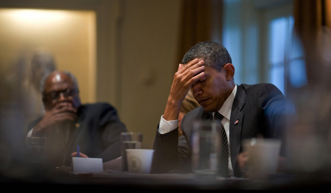 President Barack Obama pauses during a health care meeting with members of Congress in the Cabinet Room of the White House, Jan. 15. Rep. James Clyburn (D-South Carolina) is seated at left. (Source: White House)