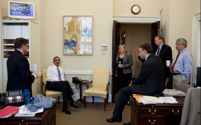 President Barack Obama listens to Dan Turton, deputy director of Legislative Affairs, during a healthcare strategy session with advisers in the Chief of Staff's Outer Office at the White House, March 20. (Source: White House)