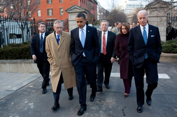 President Barack Obama walks from Blair House to the White House, following the bipartisan meeting on health insurance reform, Feb. 25, 2010. He is accompanied by Senate Majority Leader Harry Reid, House Speaker Nancy Pelosi, and Sen. Richard Durbin (D-Illinois). (Source: White House)