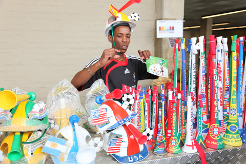 A merchant setting up his display at Soccer City, a 94,000-seat stadium in  Johannesburg that's one of 10 stadiums hosting the 2010 World Cup games in South  Africa.