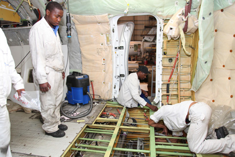 South African Airways workers overhauling an aircraft.