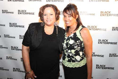 Black Enterprise Multimedia Sales Manager Raquel Mayfield-Bradford (left), strikes a pose with a colleague.