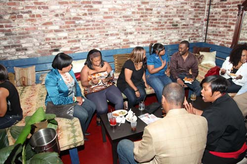 Ideas and conversation flowed, and event-goers look over recent issues of Black Enterprise magazine.