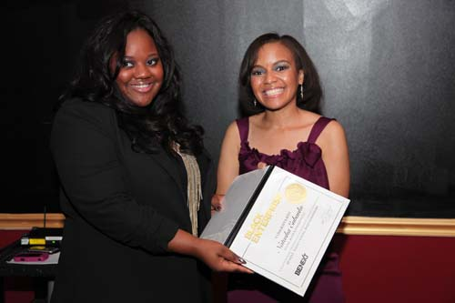 Natasha Eubanks, founder of Young, Black and Fabulous LLC, receives a BE Next certificate from Small Business Editor Tennille Robinson.