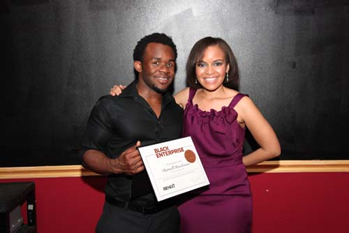 Darnell Henderson, CEO of H.I.M.-istry skincare, receives a BE Next certificate from Small Business Editor Tennille Robinson.