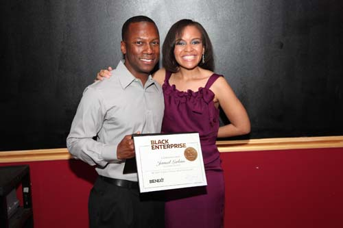 Jamail Larkins, CEO of Ascension Aircraft, receives a BE Next certificate from Small Business Editor Tennille Robinson. Larkins also won the BE Next category of the 2010 Black Enterprise Small Business Awards.