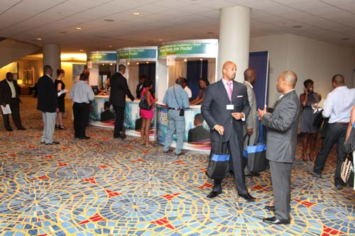 Some of the 1,200 pre-registered Black Enterprise Conference attendees check in at the registration booths and pick up the credentials they'll need for the next couple of days, including an ID badge, wristband, conference journal, and conference bag.