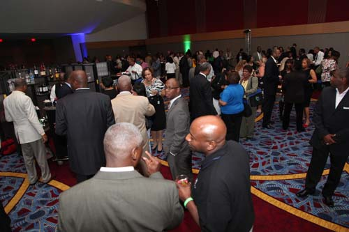 Conference-goers meet and greet each other and relax after traveling near and far to Entrepreneurs Conference headquarters, the Marriott Marquis hotel in downtown Atlanta.