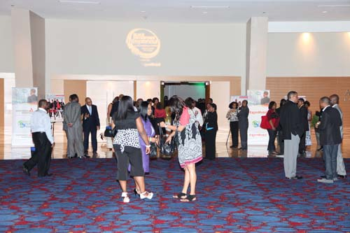 Attendees mix, mingle and socialize, mapping out their session-attending strategy over the next couple of days.