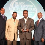 NuJak Cos. is presented with the 2010 Black Enterprise Small Business of the Year Award. (L-R) Black Enterprise CEO Earl Graves Jr., NuJack Founders Timothy Jackson and Frank Kendrick, Gary Rozier, senior vice president of institutional marketing and client services of Ariel Investments.