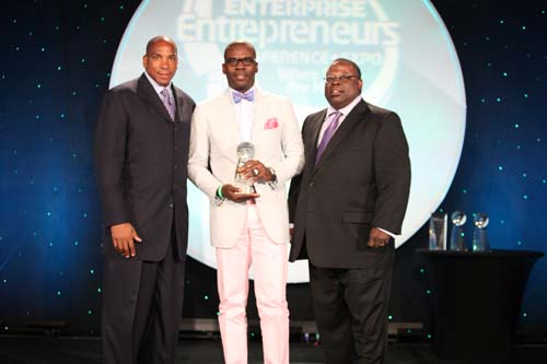 CyberSynchs L.L.C. is presented with the 2010 Black Enterprise Innovator of the Year Award. (L-R) Black Enterprise CEO Earl Graves Jr., CyberSynchs CEO Amos Winbush III, Ernest V. Freeman, senior manager of supplier diversity for PepsiCo.