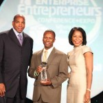 Ascension Aircraft is presented with the 2010 Black Enterprise BE Next Award. (L-R) Black Enterprise CEO Earl Graves Jr., Ascension Aircraft CEO Jamail Larkins, Vivian Pickard, director of corporate relations and grassroots initiatives for General Motors Co.