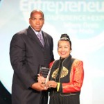 Black Enterprise CEO Earl Graves Jr. presents the Black Enterprise Community Champion Award to Xernona Clayton, founder, president and CEO of the Atlanta-based Trumpet Awards Foundation, and creator and executive producer of the Trumpet Awards.