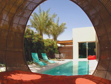 """Favorite international destination for business: Dubai. """"It is a major center of capitalism—about three hours from India, six hours from the U.K."""" The Desert Palm is his favorite hotel. """"It has polo fields in its backyard."""""""