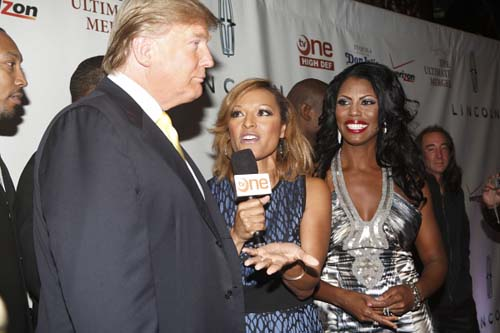 """Trump is interviewed by a TV One reporter on the red carpet at the premiere party for The Ultimate Merger, as Omarosa looks on. """"Omarosa is smart, witty and difficult, but all of these qualities will make for some very interesting entertainment,"""" says the real estate mogul, who is also executive producer of the reality show."""