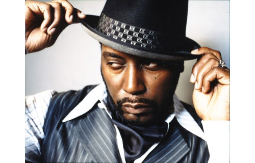 """Big Daddy Kane's flat top and three-finger rings were synonymous with rap. One of the first Casanova's in the rap game, his hits """"Set it Off,"""" """"Ain't No Half Steppin';"""" """"Raw;"""" """"Smooth Operator;"""" and """"Warm it Up, Kane"""" spawned many imitators."""
