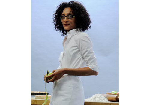 Carla Hall, chef and owner of Alchemy Caterers in Silver Spring, Maryland, realized she was a better cook than accountant or model, both vocations she tried in the past. After working for two years at Price Waterhouse and earning a CPA certificate, the Howard University Business School graduate fell in love with the art of food after visiting Paris, Milan, and London as a model.