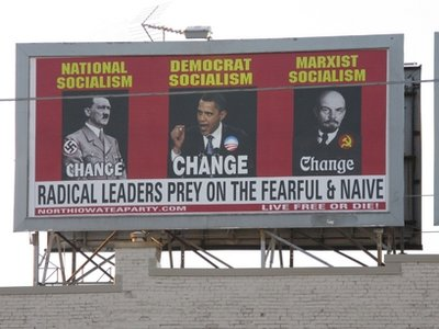 </a>This billboard, which was ordered and paid for by the North Iowa Tea Party, depicts President Barack Obama, Adolf Hitler, and Vladimir Lenin. After drawing criticism from other tea party groups, the local organization covered up the billboard.
