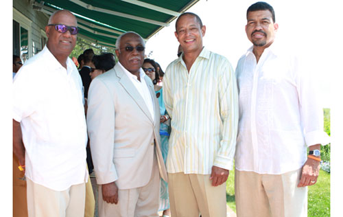 New York Urban League Chairman Noel Hankin, Robert Turner, Dr. Kevin Greenidge, and Darryl Gay enjoy the weather on the grounds of the Reginald F. Lewis estate. Proceeds from both the luncheon and the benefit will go toward the Reginald F. Lewis Museum of African American History and Culture in Baltimore.