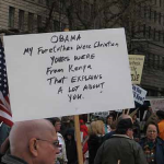 This protester takes issue with Obama's family on his father's side. (Source: Pargon's Flickr feed)