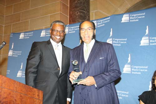 Collins with Black Enterprise Founder Earl Graves. Collins is also board treasurer of the CBC Institute.