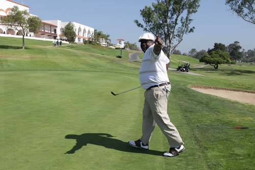 On the Thursday, September 2, the first day of the 2010 Black Enterprise/Pepsi Golf & Tennis Challenge, attendees reunited with old friends, connected with new ones, prepared for competition on the links and courts, and celebrated BE Next and the '70s. Pictured: Cedric The Entertainer takes to the greens. (Photo by Gerard Gastin)
