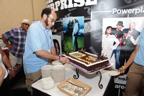 Black Enterprise Founder and Chairman Earl Graves Sr. shares slices of Black Enterprise 40th Anniversary cake. (Photo by LaToya M. Smith)