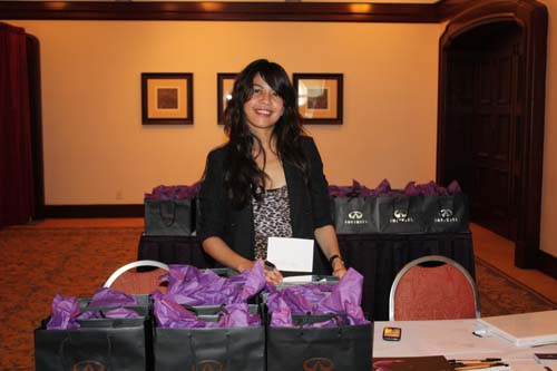 A representative from sponsor Infiniti automakers prepares gift bags for Challenge attendees. (Photo by LaToya M. Smith)