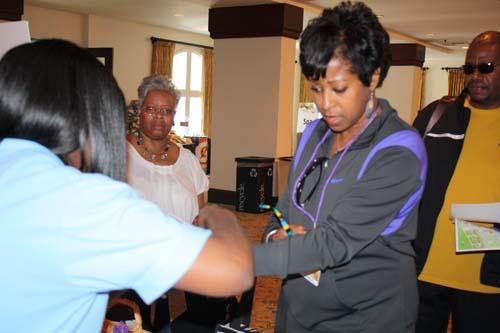 Registrant gets the purple ID band that grants access to all Challenge activities. (Photo by LaToya M. Smith)