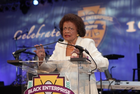 "Black Enterprise Titan Ernesta Procope, the ""First Lady of Wall Street"" and founder of E.G. Bowman Co. Inc., delivers remarks. Bowman is the first and largest minority-owned insurance brokerage firm in New York's financial district. Procope has also been recognized with the Black Enterprise Women of Power Legacy Award."