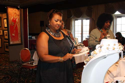 Black Enterprise Multimedia Sales VP Grace Castro samples wares in the Expo Zone. (Photo by LaToya M. Smith)