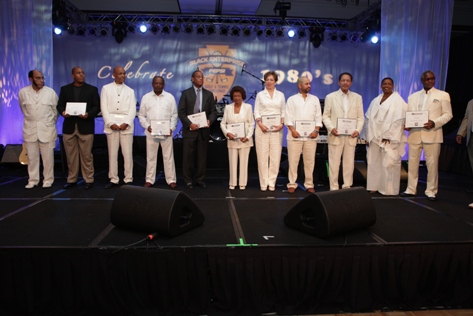 Eleven Black Enterprise Titans attended the tribute or were represented by family members or company representatives. They included Burrell Communications Founder Thomas Burrell (third from left), Brown Capital Management Founder Eddie Brown (fourth from left), and Essence Magazine Co-founder Ed Lewis (far right).