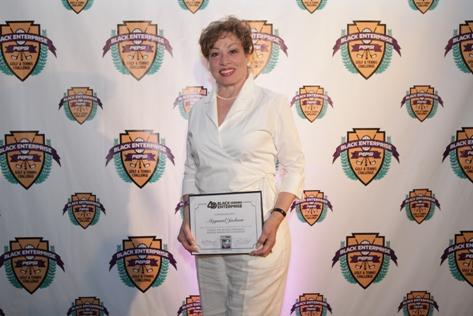 Valerie Jackson, host of the weekly radio program Between the Lines, accepts Black Enterprise Titan recognition on behalf of her late husband and former Atlanta Mayor Maynard Jackson.