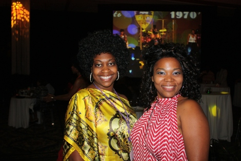 Black Enterprise Staffers Nancey Flowers and Germine Benton rock 1970s style. (Photo by LaToya M. Smith)