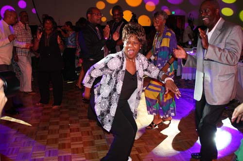 Media personality, author and motivational speaker Mother Love shows off on the dance floor. (Photo by LaToya M. Smith)