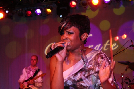 "Sol Factor lead vocalist belts out Rufus featuring Chaka Khan's ""Sweet Thing."" (Photo by LaToya M. Smith)"