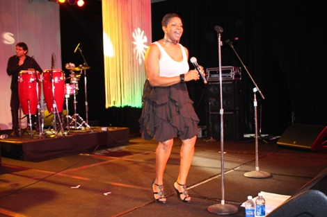 "Sol Factor vocalist delivers a groovin' rendition of Anita Ward's ""Ring My Bell."" (Photo by LaToya M. Smith)"